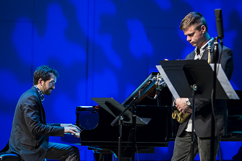 A pianist and a saxophonist performing together on stage