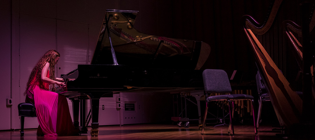 Solo pianist performs live on stage
